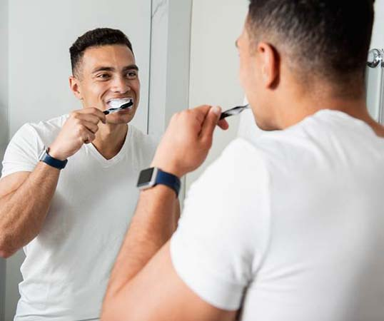 Man at dental emergency visiting holding cheek in pain