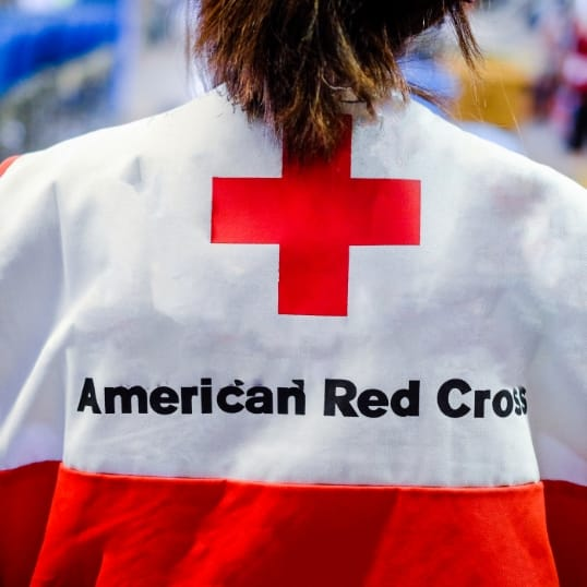 Person waring a jacket with American Red Cross logo
