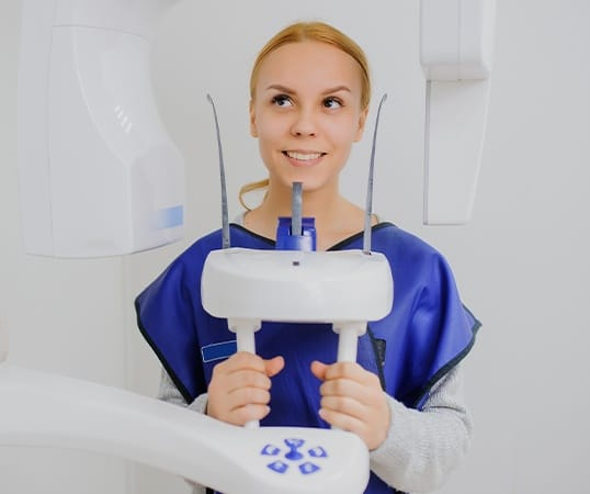 Woman receiving C T cone beam scan