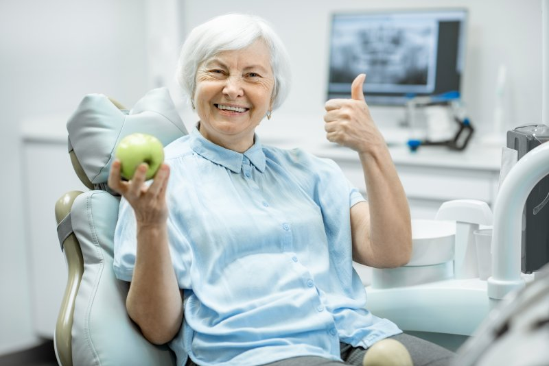 Woman smiling at dental appointment